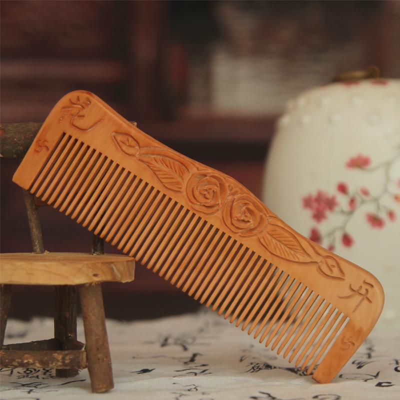 泰山兰亭轩纯天然桃木梳子/防脱发断发/除静电/按摩梳子手工艺品梳子图片